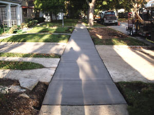 City Sidewalk - tear out and replace.