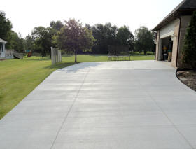 Concrete driveway with curb cut out. Grand Blanc, MI