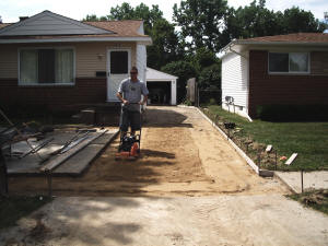 Preparing driveway for concrete work. Swartz Creek, MI