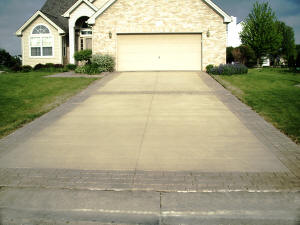 Colored concrete driveway with stamped border - Flushing, MI