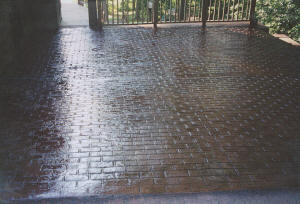 Stamped concrete patio with brick pattern. Burton, MI